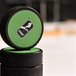 GRAND FORKS, NORTH DAKOTA - APRIL 19: IIHF warm-up pucks sit on the dasher prior to preliminary round action between Finland and Canada at the 2016 IIHF Ice Hockey U18 World Championship. (Photo by Minas Panagiotakis/HHOF-IIHF Images)