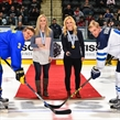GRAND FORKS, NORTH DAKOTA - APRIL 24: Former University of North Dakota women's hockey alumni Monique Lamoureux and Jocelyn Lamoureux-Davidson present the ceremonial puck drop with Sweden's Jacob Cederholm #3 and Finland's Juuso Valimaki #6 during gold medal game action at the 2016 IIHF Ice Hockey U18 World Championship. (Photo by Matt Zambonin/HHOF-IIHF Images)